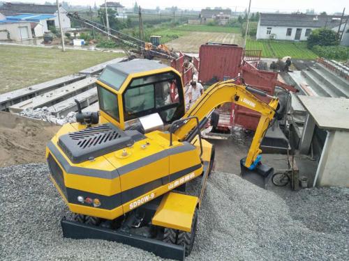 山鼎国三排放SD90W-9T轮式挖掘机施工